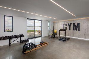 luxury home gym design in georgian bay cottage  trevor